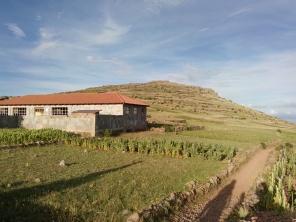 Hus på toppen av Amantani