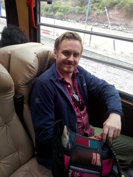 Thomas har tatt plass ombord på toget